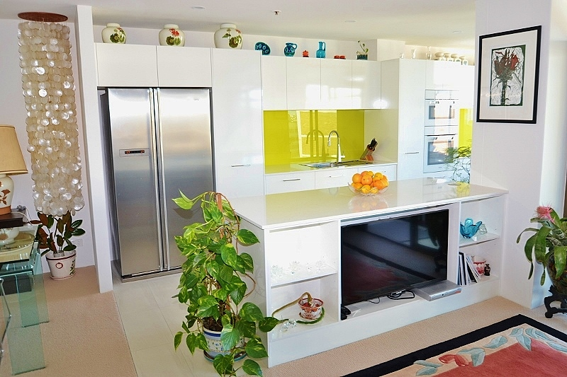 Gloss White Laminate Kitchen With A Pop Of Colour Using A Lime Green Glass  Splashback And White Stone Benchtop ...