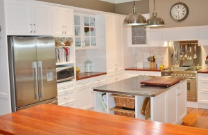 Traditional kitchen with stainless steel island benchtop